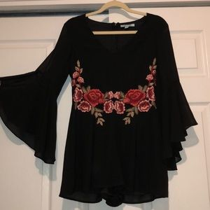 Black romper with rose design